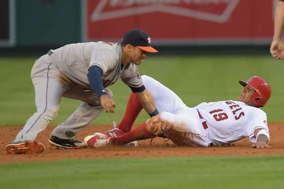ANAHEIM, CA - JUNE 27:  Jefry Marte #19 of the Los Angeles Angels is caught stealing as Carlos Correa #1 of the Houston Astros makes the tag in the second inning of the game at Angel Stadium of Anaheim on June 27, 2016 in Anaheim, California.