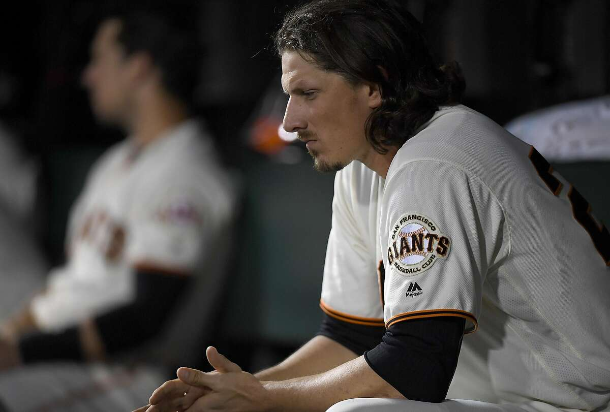 Jeff Samardzija sits in the dugout after he was taken out of the game against the Oakland Athletics in the bottom of the six inning at AT&T Park on June 27, 2016 in San Francisco.