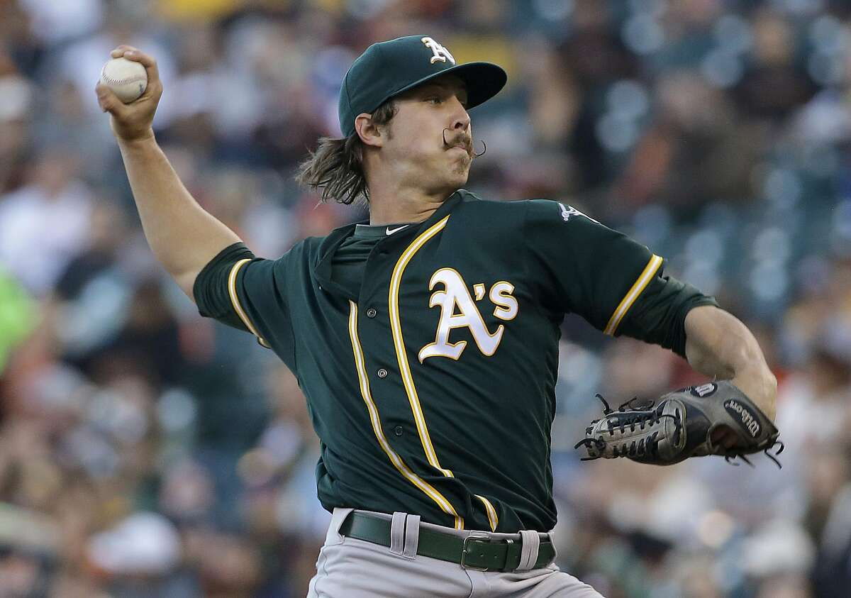 Oakland Athletics pitcher Daniel Mengden throws against the San Francisco Giants during the first inning of an interleague baseball game in San Francisco, Monday, June 27, 2016.
