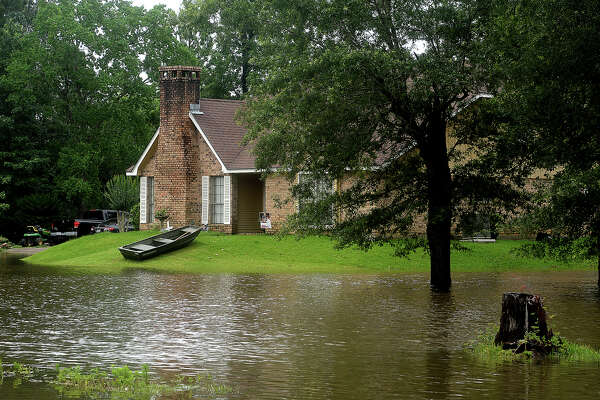 A small boat rests in the high ground surrounding a flooded portion of Pinewood Estates as flooding persists in several areas throughout Hardin County following a week of heavy rainstorms. The weather is predicted to clear today and remain dry through the week. Photo taken Saturday, June 4, 2016 Kim Brent/The Enterprise