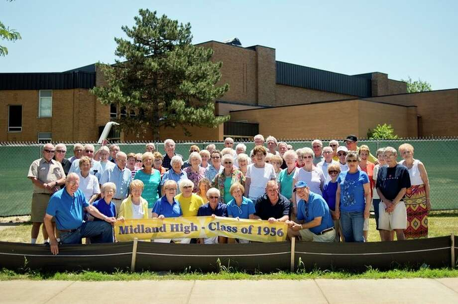 NICK KING | nking@mdn.net  Members of the Midland High School class of 1956 pose for a picture outside of Central Middle School on Saturday. / Midland Daily News