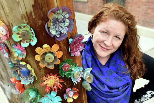 Executive Director Kristen Holler with a utility pole she decorated with flowers made from plastic bottles and caps on Tuesday, May 17, 2016, at the Albany Barn in Albany, N.Y. (Cindy Schultz / Times Union)