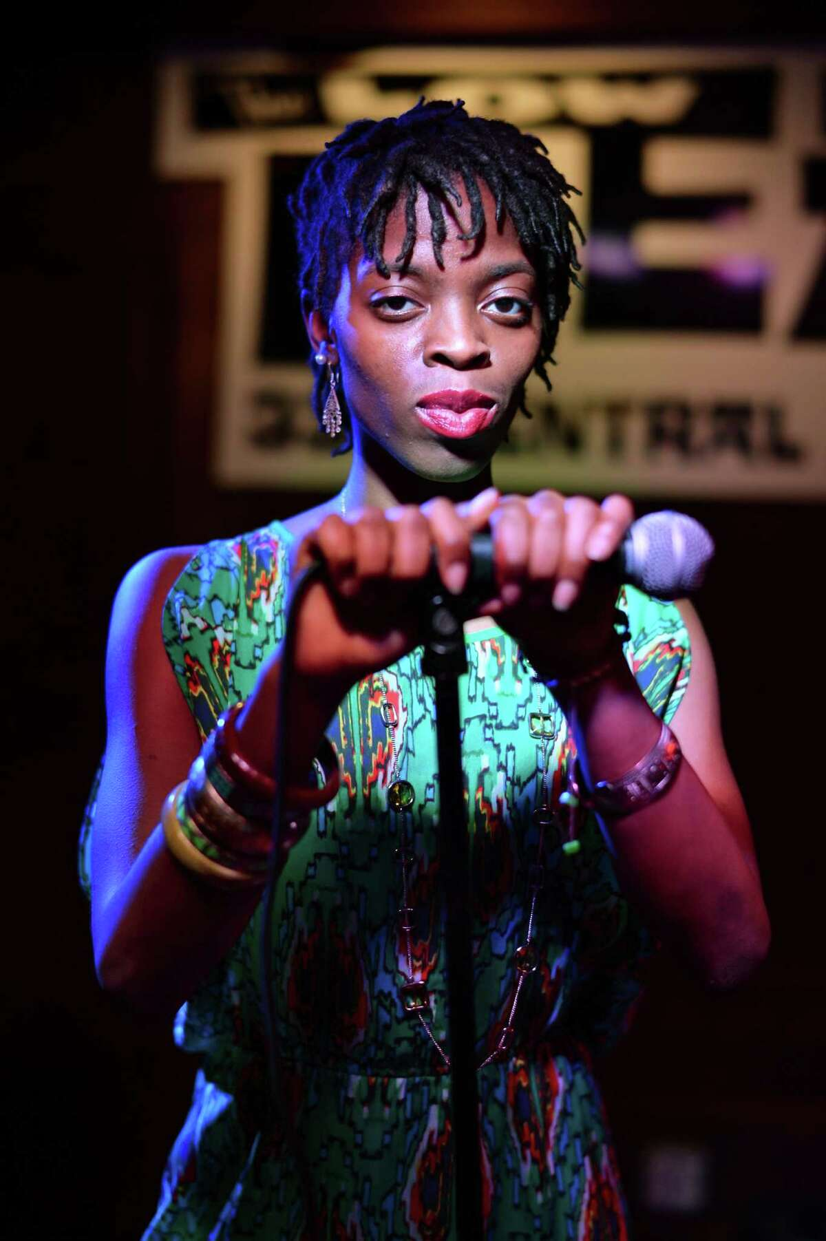 Poet Amani Olugbala on stage for a photo shoot at The Low Beat Wednesday May 25, 2016 in Albany, NY. (John Carl D'Annibale / Times Union)