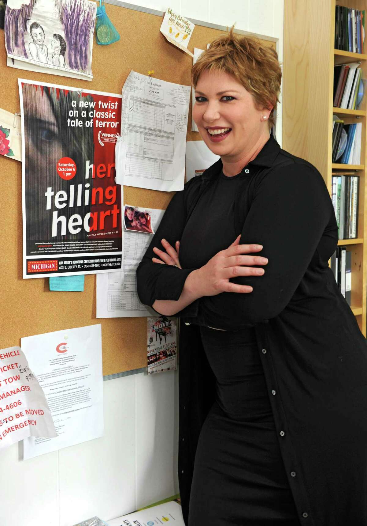 Heidi Philipsen stands next to a poster of the movie