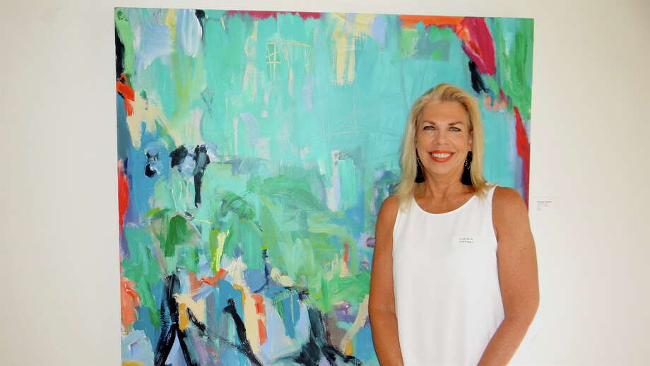 """Featured artist Claudia Mengel with her painting """"Flocking Together"""" at the opening of the """"Visible/Invisible Views"""" art show at Fairfield Library's Kershner Gallery Saturday afternoon. Photo: Mike Lauterborn / For Hearst Connecticut Media / Fairfield Citizen"""