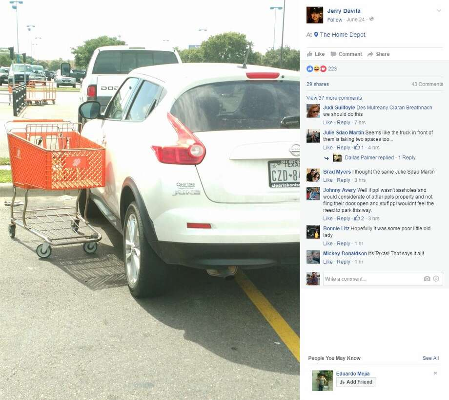 In the same handy fashion of the store, a man used a zip tie and a Home Depot shopping cart to teach the driver of a double-parked car a lesson. Photo: Jerry Davila