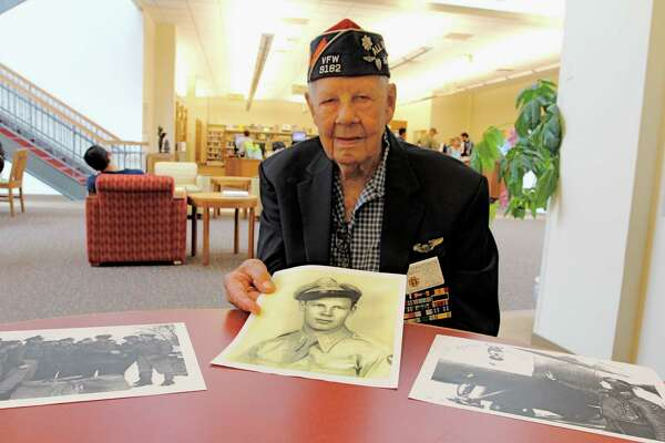 """World War II veteran, Elmer Donald """"Ed"""" Christensen, 95, of Katy, holds a copy of a photograph taken of him in January 1945 upon his return from combat in Europe.  He was 25 in the photograph and he served as an Air Force fighter pilot, flying 70 missions.    World War II veteran, Elmer Donald """"Ed"""" Christensen, 95, of Katy, holds a copy of a photograph taken of him in January 1945 upon his return from combat in Europe.  He was 25 in the photograph and he served as an Air Force fighter pilot, flying 70 missions."""