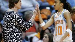 Tennessee coach Pat Summitt (left) congratulates Meighan Simmons, a former Steele High School star, as she leaves the game during the second half against Mississippi on Jan. 9, 2011 in Knoxville, Tenn.