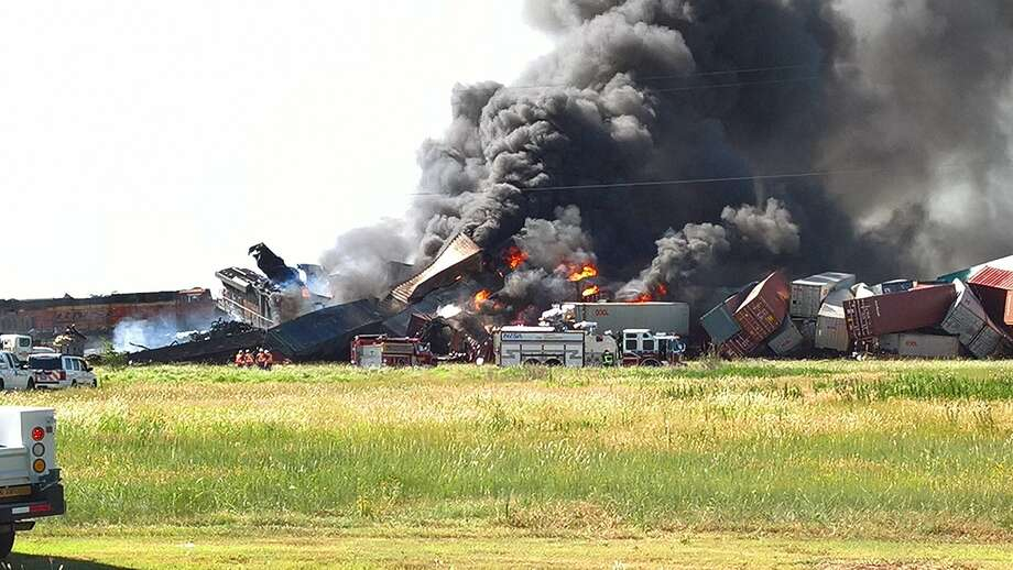 Two trains travelling in the Texas Panhandle collided Tuesday morning, causing them to derail and spark a massive blaze that continues to burn nearly two hours after the crash. Photo: Clint Walker / Twitter