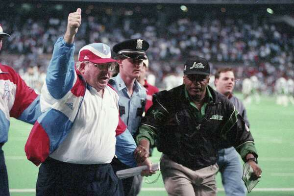 01/02/1994 - Houston Oilers v New York Jets. Oilers defensive coordinator Buddy Ryan leaving field after game