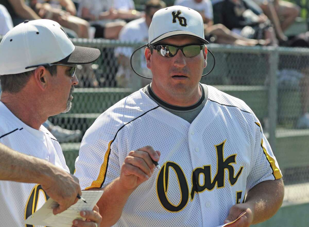 Klein Oak baseball coach Bo Hernandez (right) chats with assistant coach John Penn (left) during a 5-1 win against Georgetown in game two of the Class 5A Region II area playoffs on May 14, 2011 in Weimar. Klein Oak, which lost to Georgetown 6-2 in game one on May 13, took the best-of-three series with a 6-3 triumph in game three on May 14, 2011.