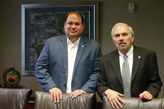 University of Texas Rio Grande Valley athletic director Chris King (left) poses June 22, 2016 with university president Guy Bailey. The two men are key figures in a feasibility study examining the possibility of starting a football program at the recently formed university.