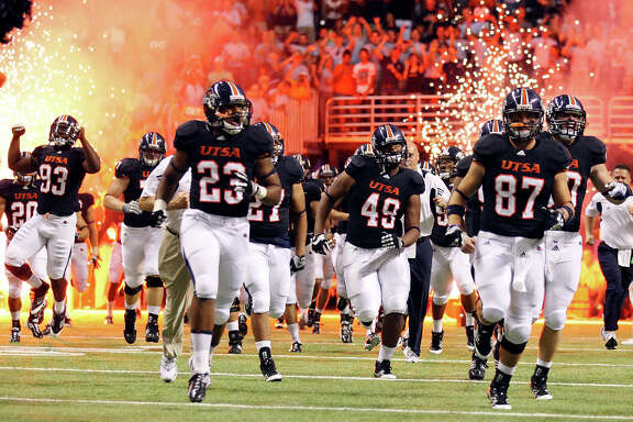 The UTSA football team takes the field against Northeastern State on Sept. 3, 2011 at the Alamodome.