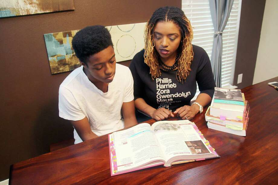 Coby Burren, a Pearland High School student, shown with  his mother, Roni, says school lessons should reflect perspectives from various cultures. Photo: Pin Lim, Freelance / Copyright Forest Photography, 2015.