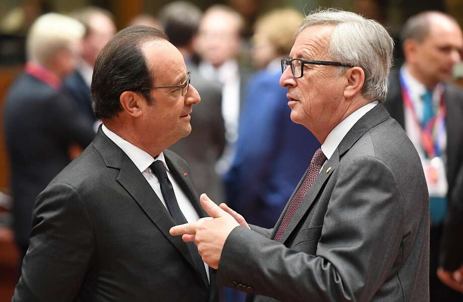 European Commission President Jean-Claude Juncker, right, speaks with French President Francois Hollande during a round table meeting at an EU summit in Brussels on Tuesday, June 28, 2016. EU heads of state and government meet Tuesday and Wednesday in Brussels for the first time since Britain voted to leave the European Union, throwing British and European politics into disarray. (AP Photo/Geert Vanden Wijngaert) Photo: Geert Vanden Wijngaert, Associated Press