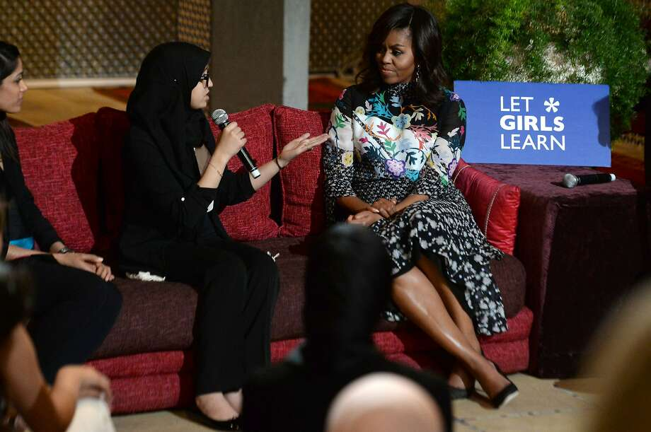 "First lady Michelle Obama listens to a young Moroccan woman in the western Moroccan city of Marrakesh following the ""Let Girls Learn"" program. Photo: FADEL SENNA, AFP/Getty Images"