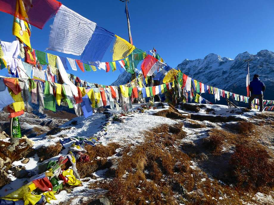 Prayer flags atop a hill above Dzongri in Sikkim. Photo: Larry Habegger, Special To The Chronicle