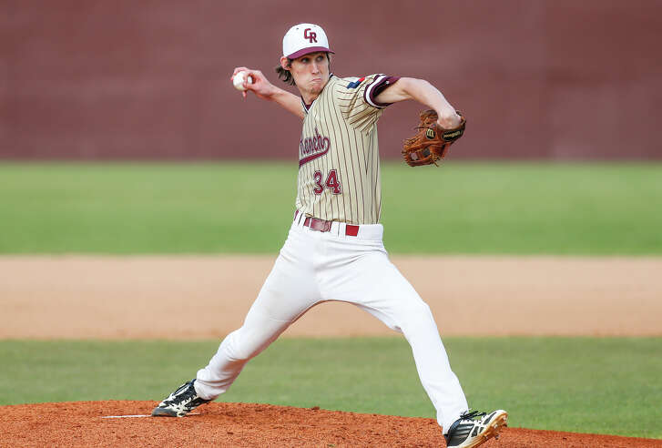 Cinco Ranch pitcher Zach Zeller fires off a pitch to a waiting Strake Jesuit batter as the two teams faced off in 19-6A District play at Cinco Ranch High School in Katy on April 1, 2016.