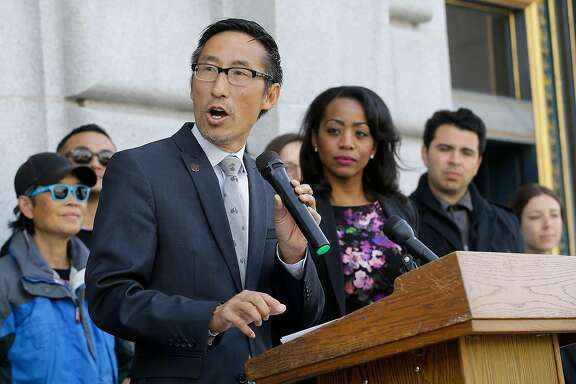 Supervisor Eric Mar, center left, speaks in front of Supervisor Malia Cohen during a news conference announcing that San Francisco backers of a tax on sugary beverages have enough signatures to put the measure on the November ballot ouside of City Hall in San Francisco, Thursday, May 12, 2016. This would be San Francisco's second attempt in two years trying to put a tax on the highly caloric drinks that some public health advocates say contributes to obesity. A 2014 attempt failed to garner the two-thirds approval needed for a dedicated tax. (AP Photo/Jeff Chiu)
