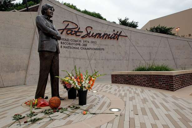 Flowers lay alongside a basketball fans have left at the Pat Summitt statue Tuesday, June 28, 2016, in Knoxville, Tenn.  Summitt, the winningest coach in Division I college basketball history who uplifted the women's game from obscurity to national prominence during her career at Tennessee, died Tuesday morning, June 28, 2016. She was 64.(AP Photo/Wade Payne)