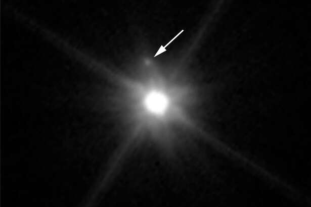 This Hubble image reveals the first moon ever discovered around the dwarf planet Makemake. The tiny satellite, located just above Makemake in this image, is barely visible because it is almost lost in the glare of the very bright dwarf planet. Hubble's sharp-eyed WFC3 made the observation in April 2015.
