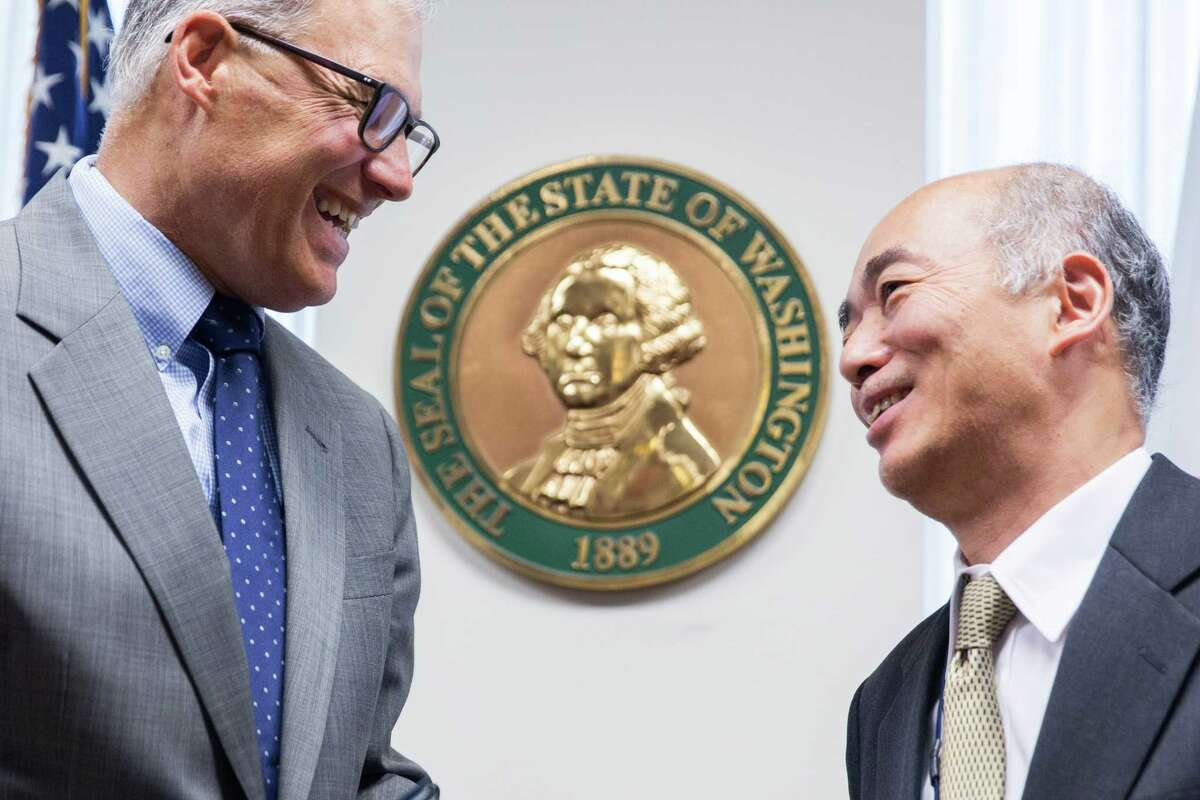 Washington Governor Jay Inslee and Japan Ambassador to U.S. Kenichiro Sasae visit after signing the Memorandum of Cooperation at the Department of Commerce in Seattle on Tuesday, June 28, 2016. The agreement is a rare agreement between a single state and a nation, aiming to strengthen trade.