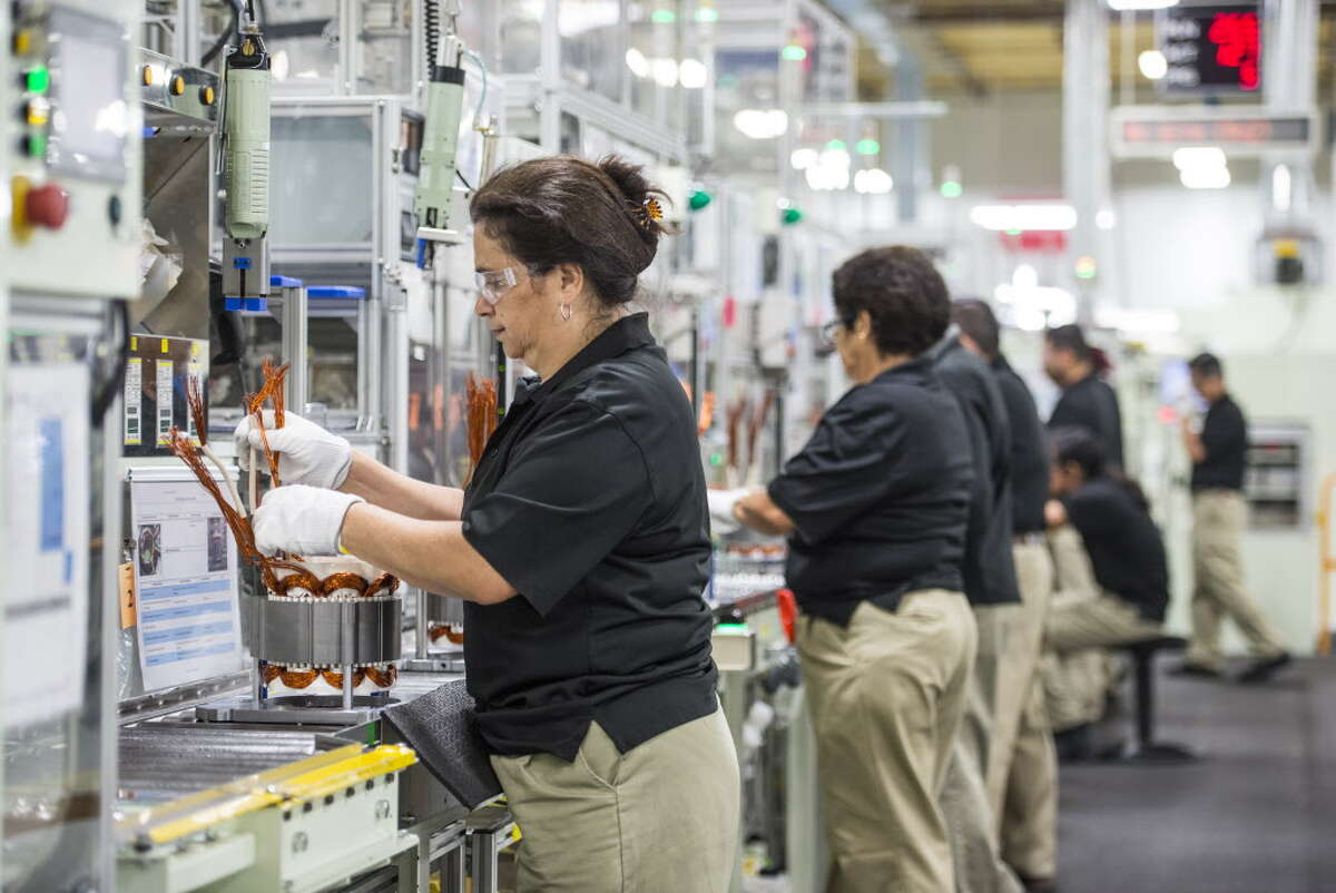 Employees build components for hybrid electric vehicle motors at the Toshiba International Corp. manufacturing facility in Houston. Automotive manufacturing industry leaders in Texas recently formed the Texas Automotive Manufacturing Association.