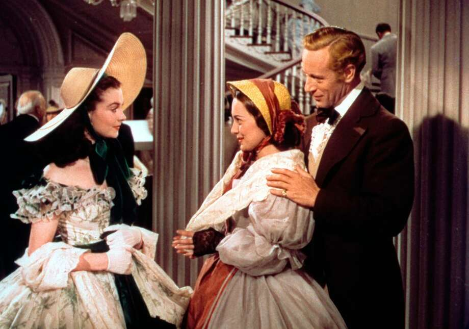 "From left: Vivien Leigh, Olivia de Havilland and Leslie Howard in ""Gone With the Wind"" (1939)."