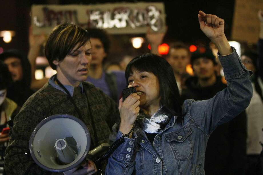 Yvette Felarca of Oakland speaks through a megaphone during a protest in Berkeley, Calif. Sunday, December 7, 2014 shining light on the chokehold death of Eric Garner in New York City and the shooting of Mike Brown in Ferguson, Missouri. Photo: Jessica Christian, The Chronicle