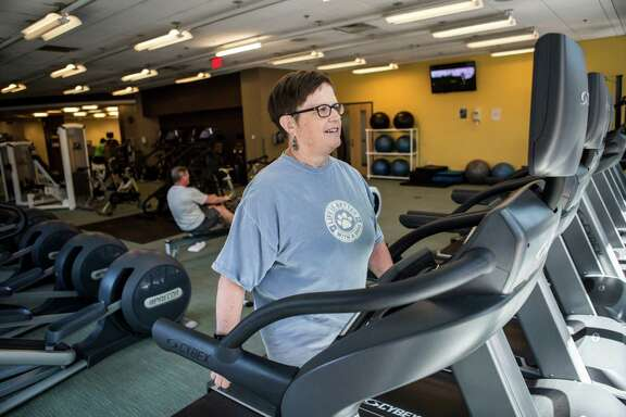 Linda Guinee, a breast cancer survivor , exercises at a gym in Boston. Scientists are recruiting 3,200 women for a large clinical trial to find out if weight loss should be prescribed as a treatment for breast cancer.