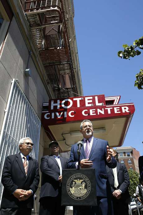 Jeff Kositsky, the director of homelessness helps to open the new Navigation Center at the Civic Center Hotel along with Mayor Ed Lee, (left) near the corner of Market and 12th streets in San Francisco, California on Tues. June 28, 2016. Photo: Michael Macor, The Chronicle