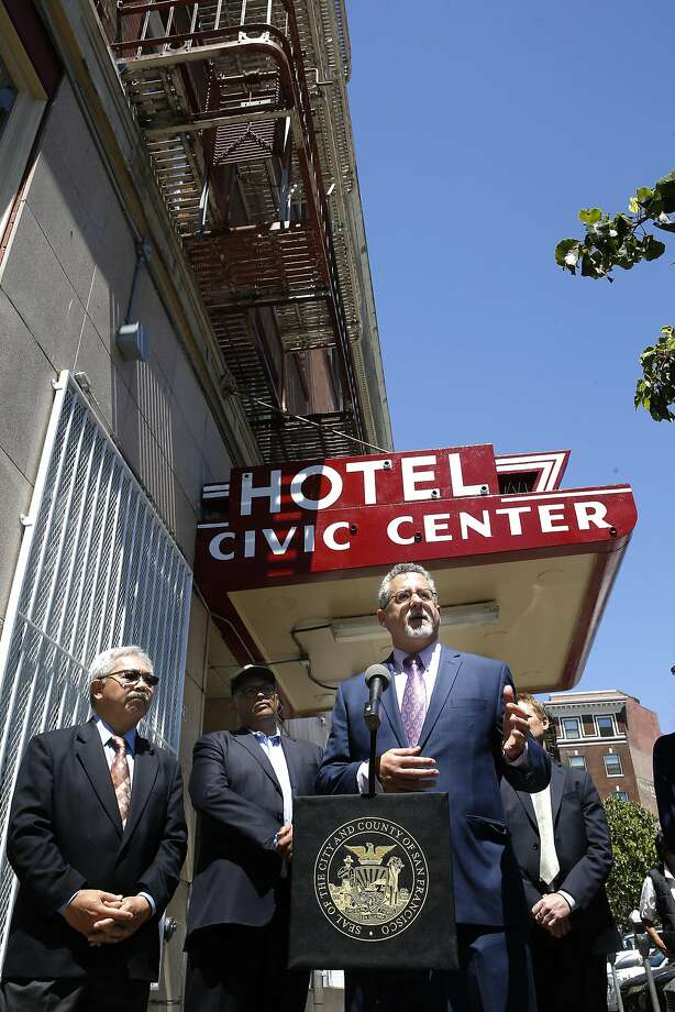 Jeff Kositsky (right), SF homelessness office director, speaks at the opening of the Navigation Center at the Civic Center Hotel along with Mayor Ed Lee (left). Photo: Michael Macor, The Chronicle
