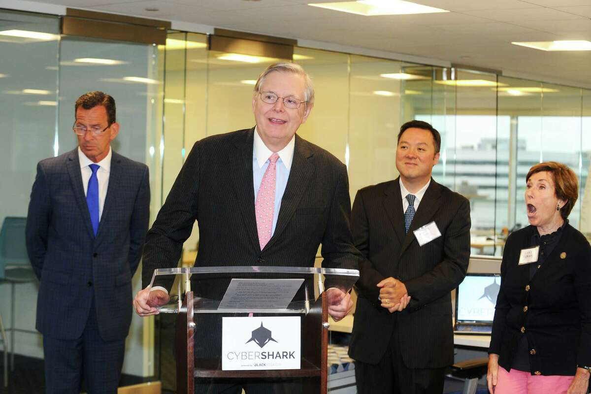 Stamford Mayor David Martin speaks during the grand opening ceremony for cyber-security firm BlackStratus inside their new office on West Broad St. in Stamford, Conn. on Tuesday, June 28, 2016.