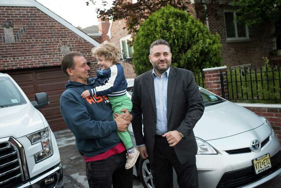 Angelo Di Maria, left, had trouble finding a buyer for the lease on a 2013 Toyota Prius driven by his father-in-law, right, whose company had given him a Ford pickup. Photo: EDWIN J TORRES, STR / NYTNS
