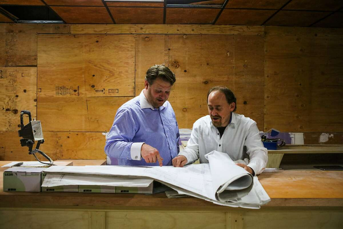 (l-r) Nick Olivero and David Gluck look at architectural drawings while discussing the construction to the theater space, The Speakeasy, in San Francisco, California, on Thursday, June 16, 2016.