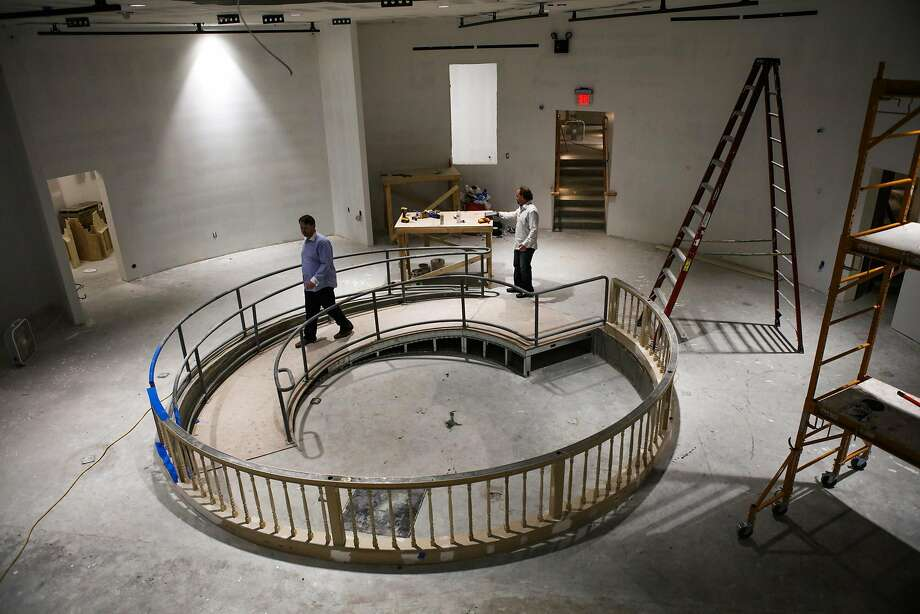 "Nick Olivero (left) and producer David Gluck walk through the theater space, during renovations in June, for ""The Speakeasy."" Photo: Gabrielle Lurie, Special To The Chronicle"