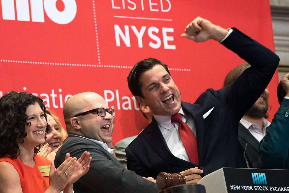 NEW YORK, NY - JUNE 23: Twilio Inc. founder and CEO Jeff Lawson (C, in glasses) reacts after ringing the opening bell to celebrate Twilio's initial public offering, at the New York Stock Exchange, June 23, 2016 in New York City. Financial markets are bracing for the outcome of Thursday's historic 'Brexit' referendum, where Britons will head to the polls to decide whether the United Kingdom should remain in the European Union. (Photo by Drew Angerer/Getty Images) Photo: Drew Angerer, Getty Images