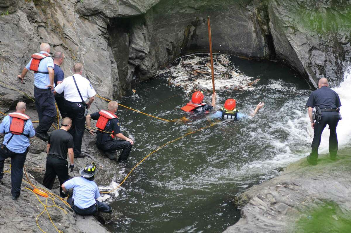 Troy emergency rescue workers search for a drowning victim in the Poestenkill Gorge on Tuesday June 28, 2016 in Troy, N.Y. A man drowned around the same area June 14, 2020. A(Michael P. Farrell/Times Union)