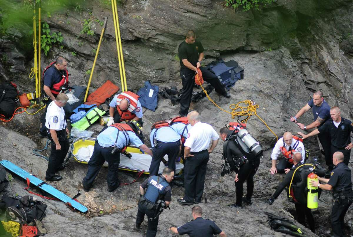 Troy emergency rescue workers secure the body of a drowning victim pulled from the Poestenkill Gorge on Tuesday June 28, 2016 in Troy, N.Y. (Michael P. Farrell/Times Union)