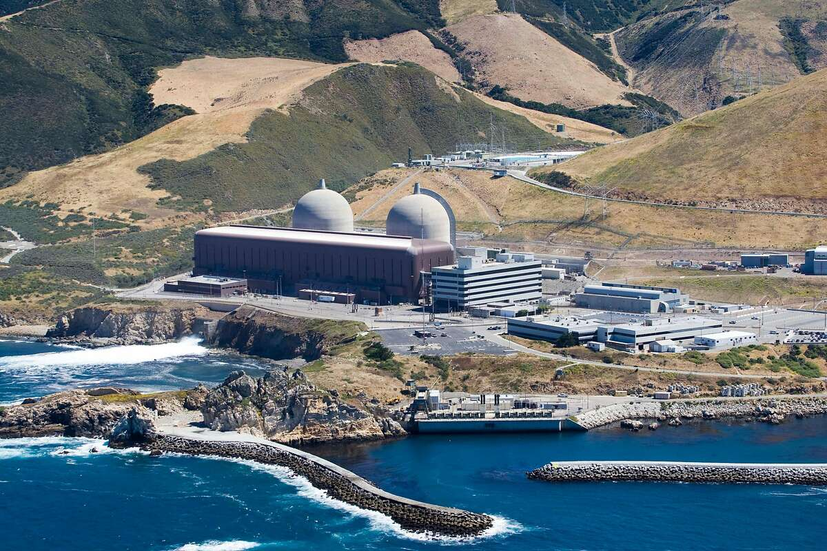 FILE - This aerial file photo taken, June 20, 2010, shows the Diablo Canyon Nuclear Power Plant, in Avila Beach, Calif. California regulators are expected to decide Tuesday, June 28, 2016, whether to drop their longstanding environmental objections to the state's last nuclear power plant in return for its promised early closing. (Joe Johnston/The Tribune (of San Luis Obispo) via AP, File) MANDATORY CREDIT