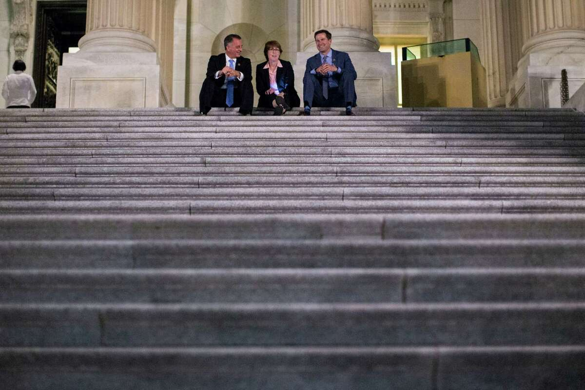 From left, Reps. David Jolly (R-Fla.), Gwen Graham (D-Fla.), and Seth Moulton (D-Mass.) sit on the steps of the U.S. Capitol and watch as supporters of the Democratic sit-in gather outside. The sit-in was staged to demand votes on gun-control legislation. A reader condemns the effort by House Democrats.