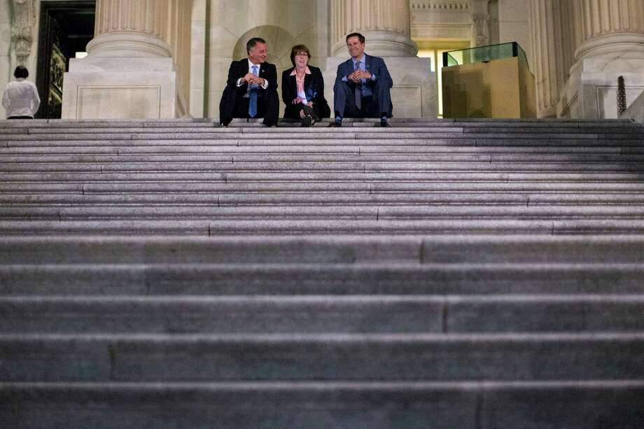 From left, Reps. David Jolly (R-Fla.), Gwen Graham (D-Fla.), and Seth Moulton (D-Mass.) sit on the steps of the U.S. Capitol and watch as supporters of the Democratic sit-in gather outside. The sit-in was staged to demand votes on gun-control legislation. A reader condemns the effort by House Democrats. Photo: AL DRAGO /NYT / NYTNS