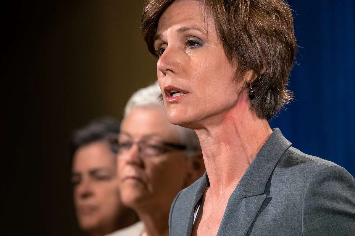 Deputy Attorney General Sally Yates, right, announces the settlement with Volkswagen during a news conference at the Justice Department in Washington, Tuesday, June 28, 2016 as EPA Administrator Gina McCarty listens at center. Volkswagen will spend more than $15 billion to settle consumer lawsuits and government allegations that it cheated on emissions tests in what lawyers are calling the largest auto-related class-action settlement in U.S. history. (AP Photo/J. David Ake)