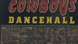 Cowboys Dancehall, a popular country music venue routinely among the most lucrative local alcohol-selling establishments, has sued one of its lenders, saying it wrongfully posted a foreclosure notice on the venue in June.