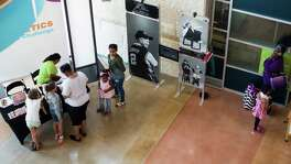 Eva's Heroes, a traveling photo exhibit featuring portraits of individuals with special needs, is displayed in a walkway at The DoSeum in San Antonio, on Tuesday, June 28, 2016.