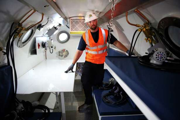 A Ballard Marine Construction worker stands in the medical lock inside a hyperbaric clinic on the site of the SR 99 tunnel project, Tuesday, June 28, 2016. A team of maintenance workers on the Bertha project, must work in a pressurized environment similar to a deep underwater dive.  The hyperbaric clinic is used in cases of medical emergencies and extended pressurized work periods.  The chamber can hold up to 10 people.
