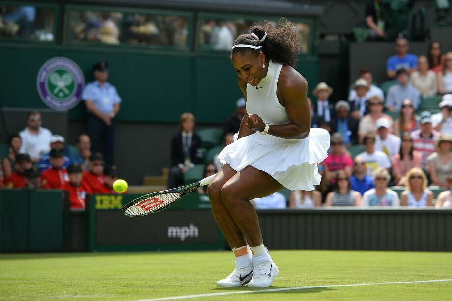 Serena Williams reacts after a point against Switzerland's Amra Sadikovic during their singles first-round match at Wimbledon. Photo: GLYN KIRK, AFP/Getty Images