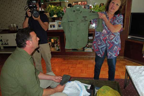 Donna Marlin of Stamford holds the U.S. Army jacket her cousin, Richard Flaherty, wore during Vietnam, when he was known around the country as the nation's smallest soldier.