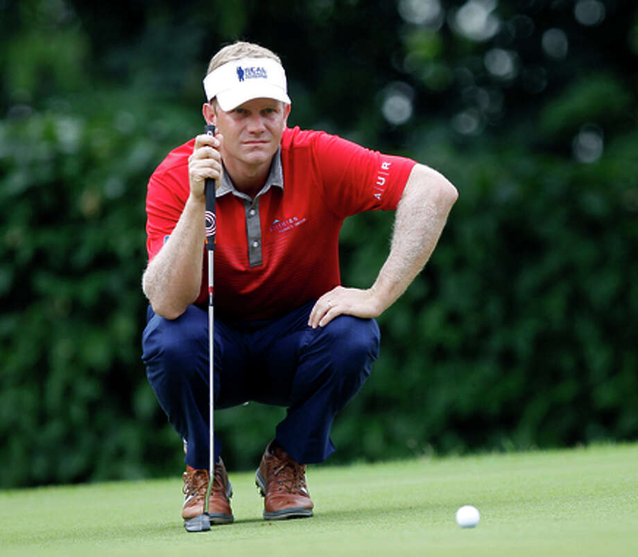Bill Hurley III of the United States lines up his putt on the 1st green during the third round of the CIMB Classic golf tournament at the Kuala Lumpur Golf and Country Club in Kuala Lumpur, Malaysia, Saturday, Nov. 1, 2014. (AP Photo/Lai Seng Sin) Photo: Lai Seng Sin / AP / AP