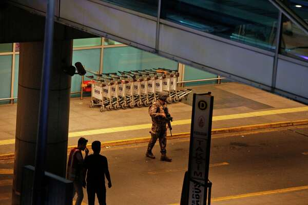 Turkish security officers gather outside Istanbul's Ataturk airport, Tuesday, June 28, 2016. Two explosions have rocked Istanbul's Ataturk airport, killing several people and wounding scores of others, Turkey's justice minister and another official said Tuesday.